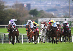 Canary Row and Ross Coakley (centre) win the Kone Handicap from Vocal Music ridden by Kevin Manning (left). during day three of the October Festival at Galway Racecourse.