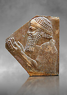Stone relief sculptured panel of a man. From corridor 10,  Inv AO 19896 from Dur Sharrukin the palace of Assyrian king Sargon II at Khorsabad, 713-706 BC.  Louvre Museum Room 4 , Paris .<br /> <br /> If you prefer to buy from our ALAMY PHOTO LIBRARY  Collection visit : https://www.alamy.com/portfolio/paul-williams-funkystock/ancient-assyria-antiquities.html  Refine search by adding background colour, place, subject, museum etc into the LOWER SEARCH WITHIN GALLERY box to <br /> <br /> Visit our ANCIENT ASSYRIAN PHOTO COLLECTIONS for more photos to download or buy as wall art prints https://funkystock.photoshelter.com/gallery-collection/Ancient-Assyrian-Art-Artefacts-Antiquities-Historic-Sites-Pictures-Images-of/C0000cjRqQyJjLag