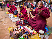 17 MARCH 2017 - KATHMANDU, NEPAL: A Buddhist monks pray during morning payers in front of Boudhanath Stupa in Kathmandu. The stupa is the holiest site in Nepali Buddhism. It is also the center of the Tibetan exile community in Kathmandu. The Stupa was badly damaged in the 2015 earthquake but was one of the first buildings renovated.         PHOTO BY JACK KURTZ