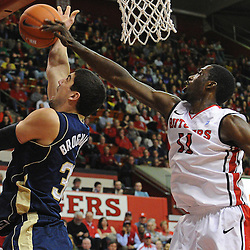Rutgers Scarlet Knights guard/forward Dane Miller (11) blocks Notre Dame Fighting Irish forward Mike Broghammer's (33) layup attempt during Big East NCAA action during Rutgers' 65-58 victory over Notre Dame at the Louis Brown Athletic Center in Piscataway, N.J.