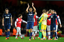 Man Utd Defender Rio Ferdinand (ENG) applauds the away supporters after the game ends with a 0-0 draw - Photo mandatory by-line: Rogan Thomson/JMP - 07966 386802 - 12/02/14 - SPORT - FOOTBALL - Emirates Stadium, London - Arsenal v Manchester United - Barclays Premier League.