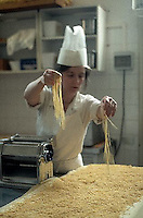 October 1989, Rome, Italy --- Chef Making Pasta --- Image by © Owen Franken/CORBIS