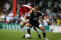 Photo: Rich Eaton.<br /> <br /> Bristol City v Swansea City. Coca Cola League 1. 07/04/2007. Lee Trundle right of Swansea holds off Bristols Liam Fontaine