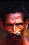 the face of a Dalit man, Aymenam, Kerala, India.
