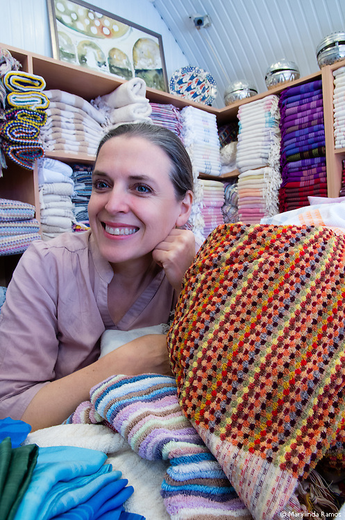 Canadian-born Jennifer Gaudet finds families with a tradtion of weaving and makes it economically viable for them to take up their craft again.  Looms are often handed down from generation to generation.  Increasingly, there is no one to whom to hand down the family business.  A glut of cheaper factory-made products has pushed the art of weaving to the fringes.  Sometimes Jennifer and staff rescue and repair looms, expecially if they were designed for intricate weaves.  She travels the country, working with designers and weavers, sourcing local cotton and silk, and drawing inspiration.  Over time, the market she has built for high-quality towels, pestamels, scarves and soaps made from locally-sourced cotton, silk and ingredients has fueled demand for three stores - and is reviving a dying art..