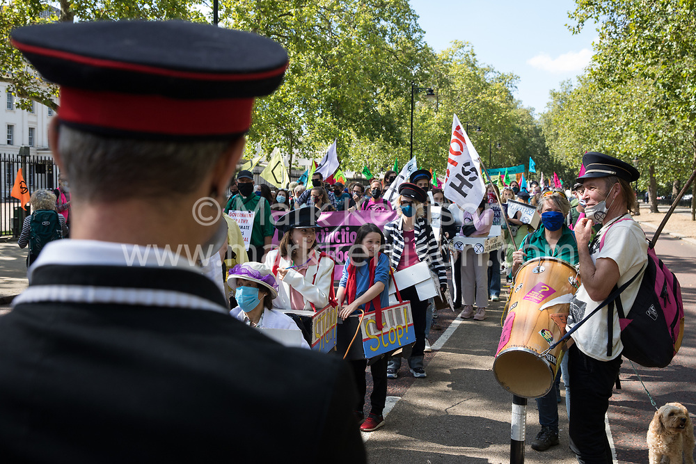London, UK. 1st September, 2020. Anti-HS2 activists from HS2 Rebellion and Stop HS2 march with a handmade 'Boris The Bank Engine' train from Buckingham Palace to a rally in Parliament Square. HS2 Rebellion activists are attending Extinction Rebellion's September Rebellion protests in London to call on the government to cancel the controversial HS2 high-speed rail link on the grounds of its hugely detrimental environmental impact and its estimated £106bn cost.