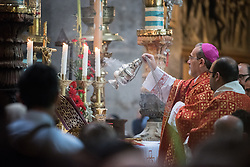 14 April 2019, Jerusalem: Palm Sunday service at the Church of the Holy Sepulchre, in the Old City of Jerusalem. Here, the head of the Roman Catholic Church in the Holy Land, titular Archbishop of Verbe and Apostolic Administrator of Jerusalem Pierbattista Pizzaballa sprays incense.