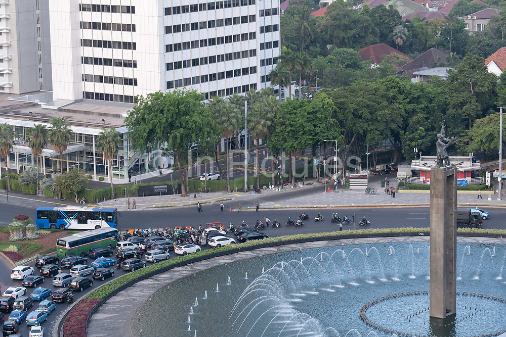Heavy traffic in central Jakarta next to the Selamat Datang monument on the 21st October 2019 in Java in Indonesia