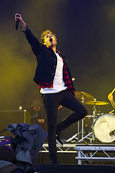 © London News Pictures. 24/08/2012. London, UK. Lead singer Josh Franceschi performing with You Me And Six  on the main stage on day one of Reading Festival 2012 in Reading, Berkshire, UK on August 24, 2012. The three day event which attracts over 80,000 music fans opens officially today (Friday) and will headline The Cure, Kasabian and The Foo Fighters Photo credit : Ben Cawthra/LNP