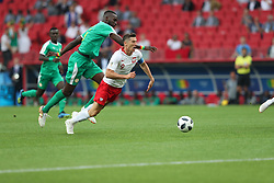 MOSCOW, June 19, 2018  Robert Lewandowski (R) of Poland is fouled by Salif Sane of Senegal during a Group H match between Poland and Senegal at the 2018 FIFA World Cup in Moscow, Russia, June 19, 2018. (Credit Image: © Ye Pingfan/Xinhua via ZUMA Wire)