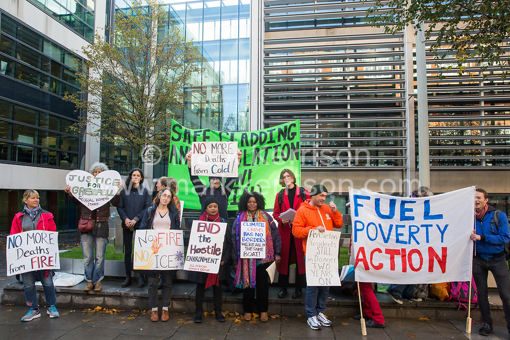 London, UK. 17 October, 2019. Campaigners from Fuel Poverty Action (FPA), residents in uninsulated homes and climate activists protest outside the Ministry of Housing, Communities and Local Government (MHCLG) before delivering a letter signed by FPA, 80 organisations, trade unions and MPs in just ten days precisely one year after a strongly worded letter about the urgency of recladding flammable buildings and insulating those that are cold was delivered to the Government department. Commitments made by the MHCLG in response to the original letter have not been met. Credit: Mark Kerrison/Alamy Live News