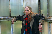 Writer Alison (A L) Kennedy leans against the old Victorian windows of Glasgow's Botanical gardens, in Scotland. Looking serious and rather troubled, she is wearing a worn leather jacket and a tartan scarf, she looks towards the ground during her portrait session for Stern Magazine. A L Kennedy is one of Britain's most respected novelists, dramatist, newspaper columnists and more recently, stand-up comedian after her 2007 performances at the Edinburgh festival. Her books include: Paradise; Indelible Acts; On Bullfighting; Everything You Need; Original Bliss; So I Am Glad; Looking for the Possible Dance;  Night Geometry & the Garscadden Trains; Now That You're back and Life & Death of Colonel Blimp. Born in Dundee on 22nd October 1965, she was educated at Dundee High School 1970 - 1983 & Warwick University 1983 - 86 (BA Hons in Theatre Studies & Drama)