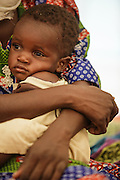 A woman holds her child, who is recovering from malnutrition, at a UNICEF-sponsored therapeutic feeding center at the Mongo hospital in the town of Mongo, Guera province, Chad on Tuesday October 16, 2012.