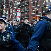 A man is arrested by police. Small groups of students followed by police moved down towards Victoria station with several arrest made after various Government Departments and shops had been targeted with paint bombs. Thousands of students turned out to a march against fees and cuts in the education sector, calling for workers and students to unite against the Government's austerity policies.