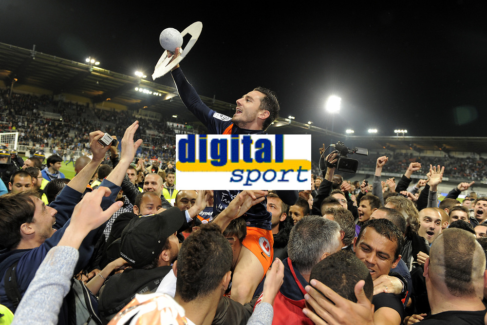 FOOTBALL - FRENCH CHAMPIONSHIP 2011/2012 - L1 - AJ AUXERRE v MONTPELLIER HSC - 20/05/2012 - PHOTO JEAN MARIE HERVIO / REGAMEDIA / DPPI - CELEBRATION GREGORY LACOMBE (MHSC) AFTER THE VICTORY IN LIGUE 1