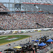 NASCAR Sprint Cup driver Greg Biffle (16) leads the pack down the front stretch during the 56th Annual NASCAR Coke Zero 400 race at Daytona International Speedway on Sunday, July 6, 2014 in Daytona Beach, Florida.  (AP Photo/Alex Menendez)