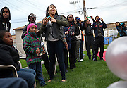 Family, friends and neighbors reacts as Teíairah Gaylord and Raymond Solomon make their red carpet entrance Friday, May 2, 2014 at their prom send-off party in an Austin backyard. Teíairah, 17, is a senior at Notre Dame High School for Girls and the celebration was at her grandmother and great-grandmotherís home. (Brian Cassella/Chicago Tribune) B583688985Z.1  ....OUTSIDE TRIBUNE CO.- NO MAGS,  NO SALES, NO INTERNET, NO TV, CHICAGO OUT, NO DIGITAL MANIPULATION...
