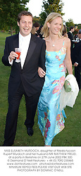 MISS ELISABETH MURDOCH, daughter of Media tycoon Rupert Murdoch and her husband MR MATTHEW FREUD, at a party in Berkshire on 27th June 2002.PBK 300