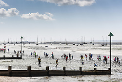 A charity fun run across the muddy foreshore at Leigh on Sea. Essex UK April 2014