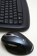 Computer keyboard and wireless mouse on white background