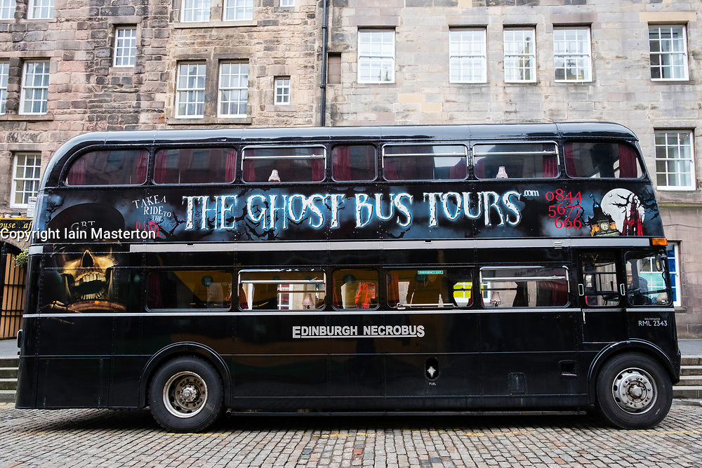 The Ghost Bus Tours double decker bus on the Royal Mile in Edinburgh, Scotland, United Kingdom