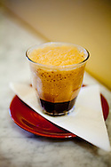 Spella Caffe, a tiny, Italian style coffee shop in downtown Portland, Oregon specializes in traditional espresso and espresso drinks using their own roasted coffee beans.  Pictured here is the shakeratto - a shot of espresso and a spoonful of sugar blended on ice in a cocktail shaker and served in a glass.