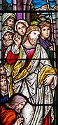 Stained glass window detail by Alexander Gibbs c 1895, Jesus healing the sick man, Aldringham church, Suffolk, England, UK