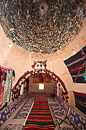 """Pictures of the beehive adobe buildings of Harran, south west Anatolia, Turkey.  Harran was a major ancient city in Upper Mesopotamia whose site is near the modern village of Altınbaşak, Turkey, 24 miles (44 kilometers) southeast of Şanlıurfa. The location is in a district of Şanlıurfa Province that is also named """"Harran"""". Harran is famous for its traditional 'beehive' adobe houses, constructed entirely without wood. The design of these makes them cool inside. 7 .<br /> <br /> If you prefer to buy from our ALAMY PHOTO LIBRARY  Collection visit : https://www.alamy.com/portfolio/paul-williams-funkystock/harran.html<br /> <br /> Visit our TURKEY PHOTO COLLECTIONS for more photos to download or buy as wall art prints https://funkystock.photoshelter.com/gallery-collection/3f-Pictures-of-Turkey-Turkey-Photos-Images-Fotos/C0000U.hJWkZxAbg ."""