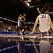 Breanna Stewart, UConn, falls to the floor after shooting during the UConn Vs Cincinnati Quarterfinal Basketball game at the American Women's College Basketball Championships 2015 at Mohegan Sun Arena, Uncasville, Connecticut, USA. 7th March 2015. Photo Tim Clayton