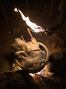 Stork in a pot, boiled to get rid of the feathers. Hunting from a blind for stork, during their migration to Africa. At and near the Hadza camp of Dedauko.