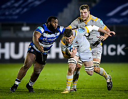 Beno Obano of Bath Rugby attempts a tackle on Tom Willis of Wasps with Joe Launchbury of Wasps in support - Mandatory by-line: Andy Watts/JMP - 08/01/2021 - RUGBY - Recreation Ground - Bath, England - Bath Rugby v Wasps - Gallagher Premiership Rugby