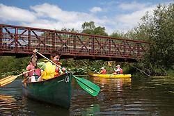 North America, United States, Washington, Bellevue, woman and boy (age 9) kayaking under bridge in Mercer Slough Nature Park.  MR