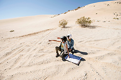 October 17, 2018 - Johnson Valley, California, U.S. - WENDY FISHER, left, and BROOKE JACKSON plot their course on Day 5 of the third annual Rebelle Rally, the first women's off-road navigation rally in the United States. The event features a unique scoring system in which precise navigation - not speed - is the ultimate goal.  With cell phones and GPS devices banned during the 10-day event, and armed with just maps, compasses and roadbooks, 43 two-person teams are tasked with scoring points based on time, distance and hidden checkpoints as they make their way across 1,600 miles of scrub brush, sand dunes and boulders in the Nevada and California desert.(Credit Image: © Brian Cahn/ZUMA Wire)