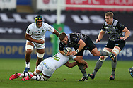 Scott Otten of the Ospreys © is tackled by Alexandre Lapandry of Clermont Auvergne .European Rugby Champions Cup, pool 2 match, Ospreys v ASM Clermont Auvergne at the Liberty Stadium in Swansea, South Wales on Sunday 15th October 2017.<br /> pic by  Andrew Orchard, Andrew Orchard sports photography.