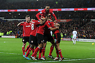 Cardiff city players celebrate after Steven Caulker scores the opening goal. Barclays Premier League match, Cardiff city v Swansea city at the Cardiff city stadium in Cardiff, South Wales on Sunday 3rd Nov 2013. pic by Andrew Orchard, Andrew Orchard sports photography,