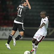 Gaziantepspor's Dany NOUNKEU (R) and Besiktas's Mustafa PEKTEMEK (L) during their Turkish superleague soccer match Gaziantepspor between Besiktas at the Kamil Ocak stadium in Gaziantep Turkey on Monday 03 October 2011. Photo by TURKPIX