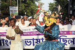 May 19, 2017 - Kolkata, West Bengal, India - Artist from Dinajpur perform Gomira dance during the rally. Activist organized a rally in the memory of language martyrs of Silchar (Assam) in Kolkata. Eleven people were killed by Assam State Police during the Bengali Language Movement or protest against Assam Government decision to make Assamese only official language of the state..Activist organized a rally in the memory of language martyrs of Silchar (Assam) in Kolkata. Eleven people were killed by Assam State Police during the Bengali Language Movement or protest against Assam Government decision to make Assamese only official language of the state. (Credit Image: © Saikat Paul/Pacific Press via ZUMA Wire)