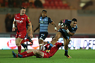 Willis Halaholo of Cardiff Blues ® is stopped by Rhys Patchell of the Scarlets (on ground). . Guinness Pro14 rugby match, Scarlets v Cardiff Blues  at the Parc y Scarlets in Llanelli, West Wales on Saturday 28th October 2017.<br /> pic by  Andrew Orchard, Andrew Orchard sports photography.