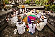 A group of pilgrims from the same village praying at the holy temple, Pura Besakih Mother Temple, Mount Agung, Indonesia