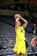 CHARLOTTESVILLE, VA- NOVEMBER 29: Colton Christian #45 of the Michigan Wolverines shoots the ball before the game against the Virginia Cavaliers on November 29, 2011 at the John Paul Jones Arena in Charlottesville, Virginia. Virginia defeated Michigan 70-58. (Photo by Andrew Shurtleff/Getty Images) *** Local Caption *** Colton Christian