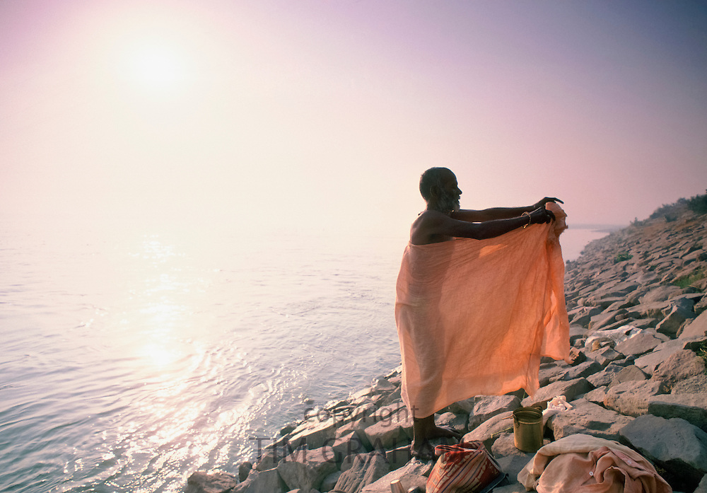 Indian man doing traditional bathing in River Ganges, India