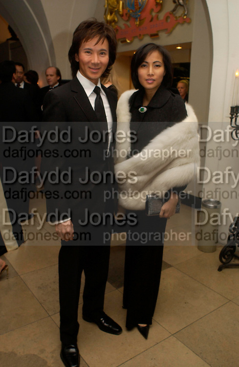 Andy and Patti Wong. Dinner to unveil the Van Cleef & Arpels jewellery collection 'Couture' with fashion by Anouska Hempel Couture. The Banqueting House, Whitehall Palace, London on 8th March 2005.ONE TIME USE ONLY - DO NOT ARCHIVE  © Copyright Photograph by Dafydd Jones 66 Stockwell Park Rd. London SW9 0DA Tel 020 7733 0108 www.dafjones.com