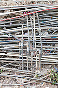 A tangle of illegal water pipes in the Munika area. New Delhi, India