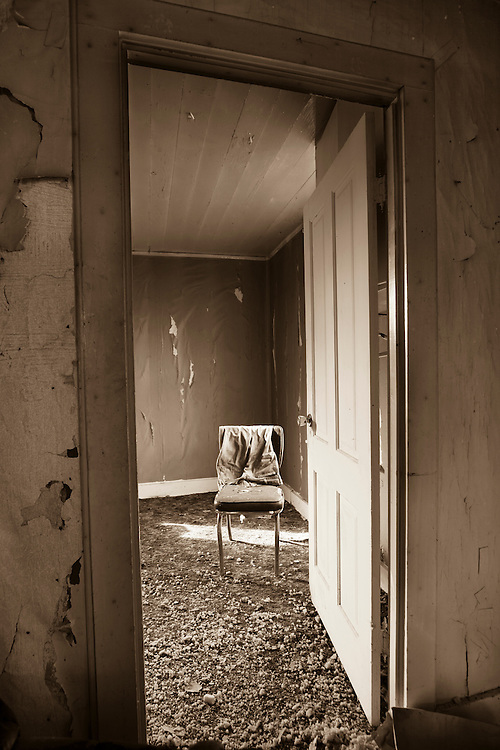 An old pair of jeans is draped over a broken chair in an abandoned homestead on the high desert of central Oregon.