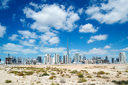 Skyline of Dubai from the desert in United Arab Emirates