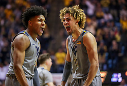 Mar 7, 2020; Morgantown, West Virginia, USA; West Virginia Mountaineers guard Miles McBride (4) and forward Emmitt Matthews Jr. (11) celebrate after a play during the second half against the Baylor Bears at WVU Coliseum. Mandatory Credit: Ben Queen-USA TODAY Sports
