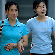 Fashion in North Korea<br /> <br /> In every corner of the earth, women love to look beautiful and keep up with the latest fashion trends. The women of North Korea are no different. Fashion is taken seriously here. But in North Korea, women do not read Elle or Vogue; they just glimpse a few styles by watching TV or by observing the few foreigners who come to visit. In the hermit kingdom, clothing also reflects social status. If you have foreign clothes it means you travel and are consequently close to the centralized power. Chinese products have inundated the country, adding some color to the traditional outfits that were made of vynalon fiber. But citizens beware, too much style means you're forgetting the North Korean juche, the ethos of self-reliance that the country is founded on! But the youth tend to neglect it despite the potential consequences.<br /> <br /> Photo shows: Clash of civilization... Kil Il Sung Vs Prada...<br /> ©Eric Lafforgue/Exclusivepix Media