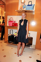 GWYNETH PALTROW at a party to celebrate the opening of the Louis Vuitton Bond Street Maison, New Bond Street, London on 25th May 2010.