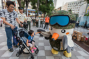 Touchi, a mascot for the Tokyo area Japanese Self Defence Force (JSDF) greats a baby in a stroller. Ikebukuro, Tokyo, Japan Friday September 29th 2017. The Ministry of Defence, each Autumn starts a recruitment drive to encourage more young people to join the Japanese Self Defence Force. Military service in Japan is neither compulsory nor popular and with regional tensions increasing and Hawkish politicians in power they are gain to raise the number of military personnel available.