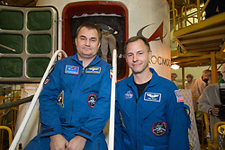 At the Baikonur Cosmodrome in Kazakhstan, Expedition 57 crewmembers Alexey Ovchinin of Roscosmos (left) and Nick Hague of NASA (right) pose for pictures Oct. 6 in front of the Soyuz MS-10 spacecraft. They will launch Oct. 11 from the Baikonur Cosmodrome on the Soyuz MS-10 spacecraft for a six-month mission on the International Space Station.<br /> <br /> NASA/Victor Zelentsov